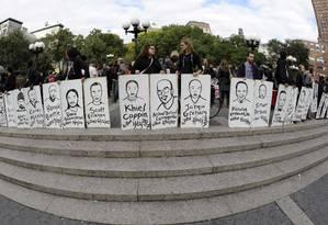 Manifestantes fazem protesto em Nova York contra a brutalidade policial em outubro de 2011 Foto: TIMOTHY A. CLARY / AFP/Arquivo