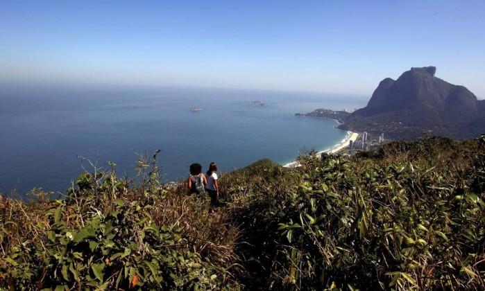 Antes da chegada da UPP, poucos se aventuravam em percorrer a trilha Custódio Coimbra / Agência O Globo
