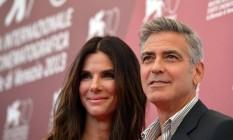 George Clooney e Sandra Bullock no Festival de Veneza, onde foi lançado o filme 'Gravidade', de Alfonso Cuarón Foto: GABRIEL BOUYS / AFP Photo