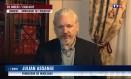 Julian Assange dá em entrevista à TV francesa TF1 da embaixada do Equador em Londres Foto: - / AFP