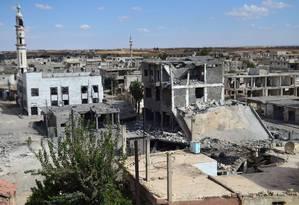 Após mais de quatro anos de conflito, cidade de Talbisseh, na província de Homs, é cenário de destruição Foto: MAHMOUD TAHA / AFP