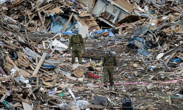 Várias cidades costeiras foram inteiramente destruídas Foto: AFP