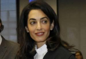 Amal Clooney auta como advogada em defesa dos direitos humanos Foto: Christian Lutz / AP
