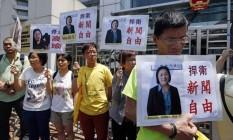 Manifestantes protestam contra prisão de jornalista na China Foto: Kin Cheung / AP