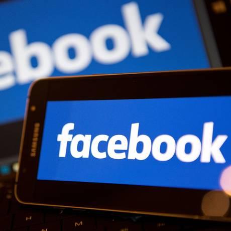 Facebook no centro de escândalo de vazamento de dados através da empresa Cambridge Analytica Foto: JUSTIN TALLIS / AFP
