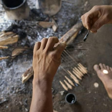 Veneno indígena 'curare' é empregado em flechas Foto: Eric Feferberg / AFP