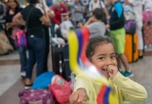 Criança venezuelana imigrante: milhares de cidadãos deixam o país com o agravamento da crise Foto: ERIKA SANTELICES / AFP