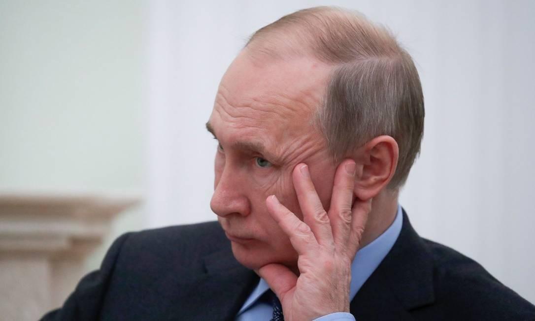 O presidente russo Vladimir Putin em uma reunião no Kremlin no dia 30 de janeiro Foto: MAXIM SHEMETOV / AFP