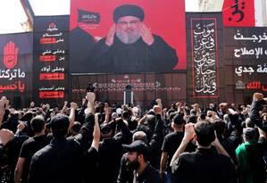 O líder do Hezbollah Sayyed Hassan Nasrallah em um discurso em um telão transmitido em Beirute, no Líbano Foto: Aziz Taher / REUTERS