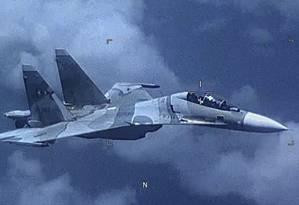 Foto do Comando Sul americano de um caça Su-30 Flanker da Venezuela que voou ao lado de um avião militar americano EP-3 Aries II na sexta-feira Foto: MICHAEL WIMBISH / AFP/ Comando Sul do Exército americano