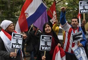 Manifestantes pedem o impeachment do presidente do Paragua Mario Abdo Benitez em Assunção Foto: NORBERTO DUARTE / AFP 27-7-19