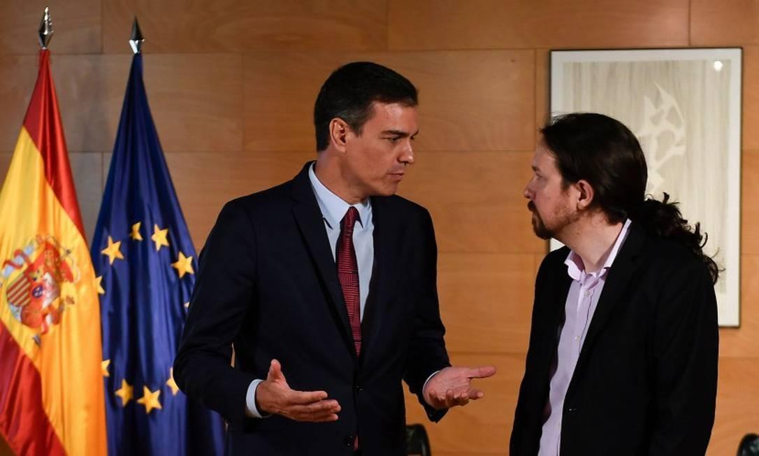 O primeiro-ministro da Espanha, o socialista Pedro Sánchez, e o líder do Podemos, Pablo Iglesias Foto: PIERRE-PHILIPPE MARCOU / AFP 9-7-19