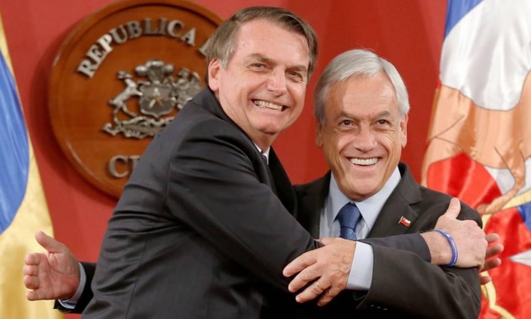 Os presidentes Jair Bolsonaro e Sebastián Piñera em um encontro em Santiago em março Foto: Rodrigo Garrido / Reuters 23-3-19