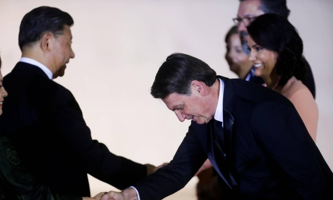 O presidente Jair Bolsonaro e sua mulher, Michelle Bolsonaro, saúdam o presidente chinês Xi Jinping e sua mulher, Peng Liyuan, no Palácio Itamaraty Foto: ADRIANO MACHADO / REUTERS 13-11-19