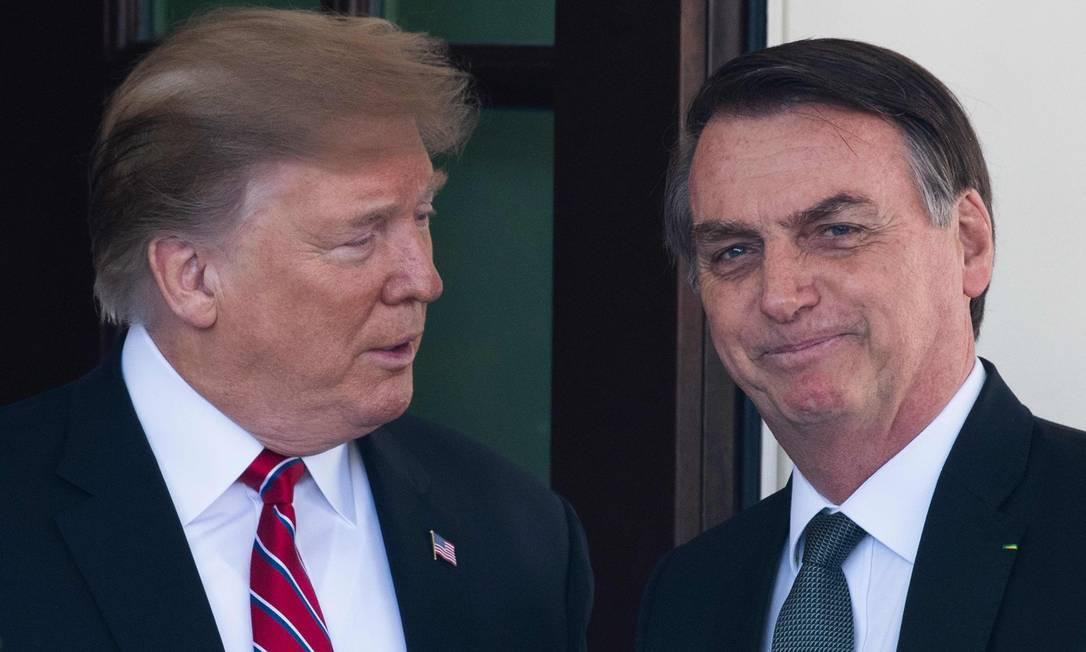 O presidente dos EUA, Donald Trump, e do Brasil, Jair Bolsonaro, em visita do brasileiro a Washington em março de 2019 Foto: JIM WATSON / AFP