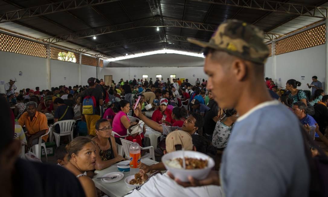 Local para distribuição de comida aos venezuelanos em Roraima Foto: Daniel Marenco / Agência O Globo 26-7-19