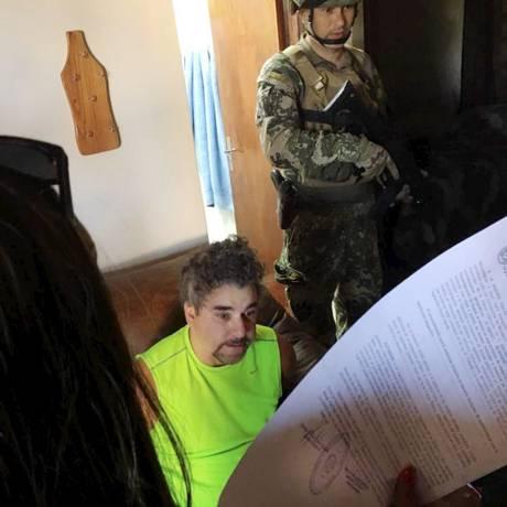 Traficante Marcelo Piloto ao ser preso no Paraguai em dezembro de 2017 Foto: Agência O Globo